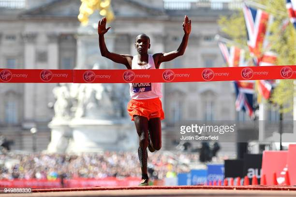 Eliud Kipchoge of Kenya crosses the finish line to take first place during the Virgin Money London Marathon at United Kingdom on April 22 2018 in...