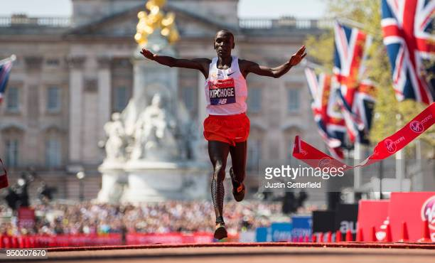 Eliud Kipchoge of Kenya crosses the finish line to win the elite men's race during the Virgin Money London Marathon at United Kingdom on April 22...