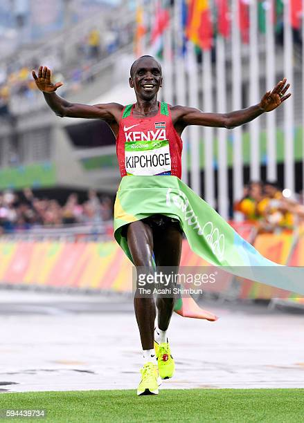 Eliud Kipchoge of Kenya crosses the finish line to win the gold medal in the Men's Marathon on Day 16 of the Rio 2016 Olympic Games at Sambodromo on...