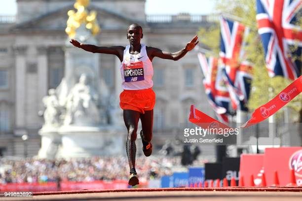 Eliud Kipchoge of Kenya crosses the finish line to win the men's race during the Virgin Money London Marathon at United Kingdom on April 22 2018 in...