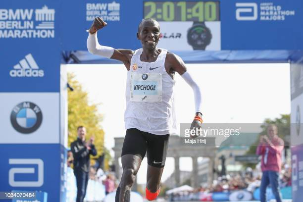 Eliud Kipchoge of Kenya crosses the finishing line to win the Berlin Marathon 2018 in a new world record time of 2:01:40 hours on September 16, 2018...