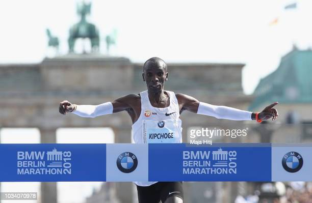 Eliud Kipchoge of Kenya crosses the finishing line to win the Berlin Marathon 2018 in a new world record time of 20140 hours on September 16 2018 in...