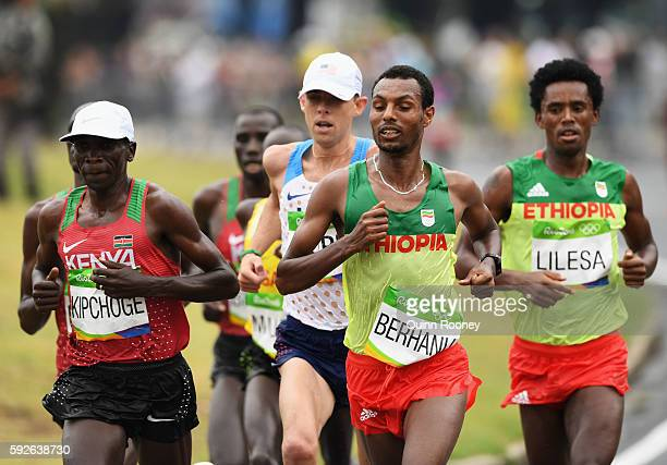 Eliud Kipchoge of Kenya Galen Rupp of the United States Lemi Berhanu of Ethiopia and Feyisa Lilesa of Ethiopia compete during the Men's Marathon on...