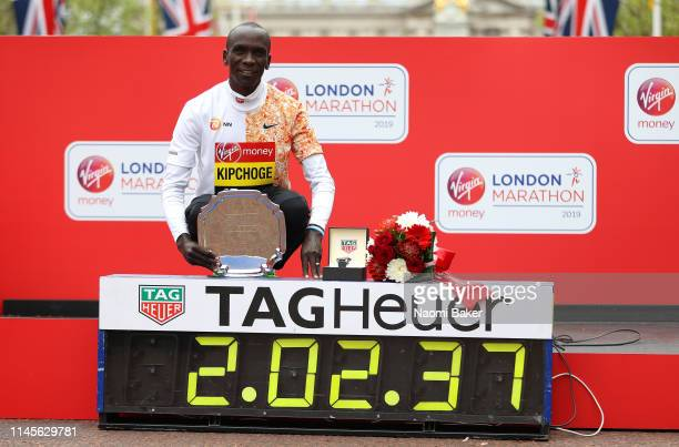 Eliud Kipchoge of Kenya poses for a photo after winning the Men's Elite race and breaking the race record during the 2019 Virgin Money London...