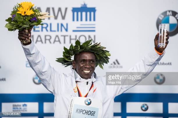 Eliud Kipchoge of Kenya smiles during a podium ceremony after winning the Berlin Marathon 2018 in a new world record time of 20139 hours on September...
