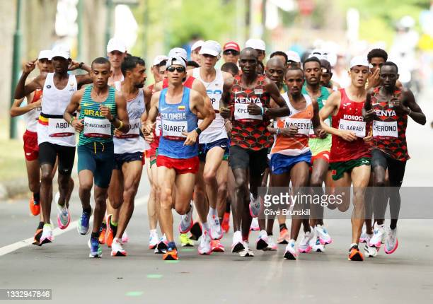Eliud Kipchoge of Team Kenya, center, competes in the Men's Marathon Final on day sixteen of the Tokyo 2020 Olympic Games at Sapporo Odori Park on...