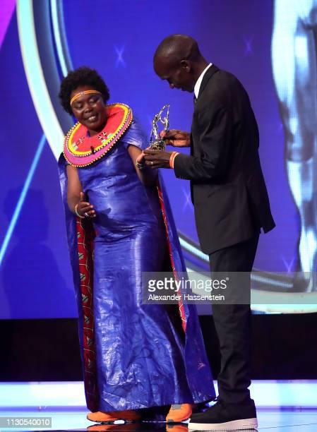 Eliud Kipchoge winner of the Laureus Academy Exceptional Award 2019 accepts his Laureus award on stage from Laureus Academy Member Tegla Loroupe...