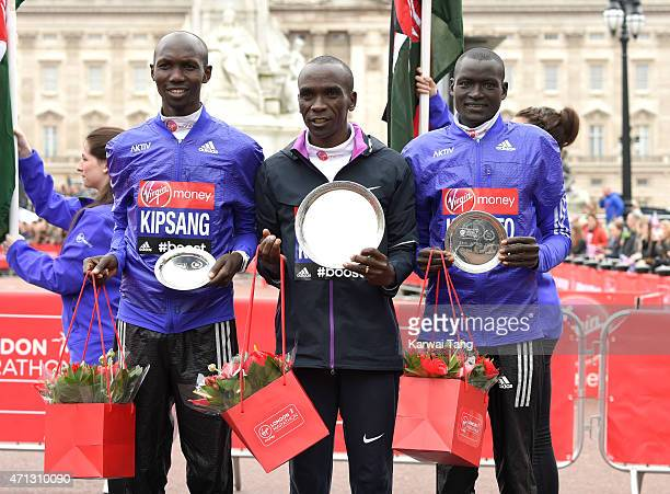 Eliud Kipchoge winner of the mens Elite race with 2nd place Wilson Kipsang and 3rd place Dennis Kimetto pose for the cameras at the London Marathon...