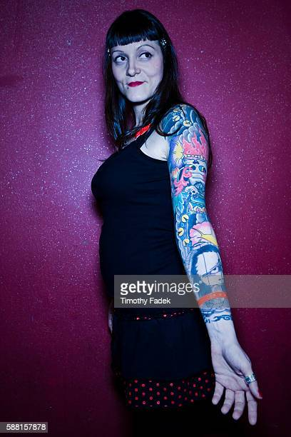 Eliza a woman from Italy displays her tattoos at the 12th Annual New York City Tattoo Convention at Roseland Ballroom in Manhattan