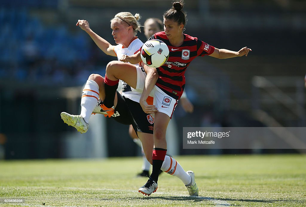 Eliza Ammendolia of the Wanderers and Nina Frausing-Pedersen of the Roar compete for the ball during the round four W-League match between the Western Sydney Wanderers and the Brisbane Roar at Marconi Stadium on November 26, 2016 in Sydney, Australia.