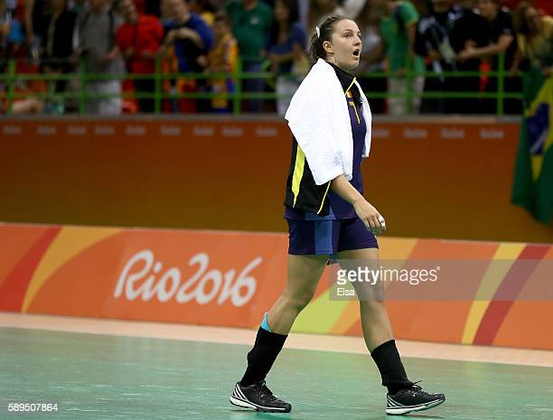 Eliza Buceschi of Romania walks off the court after the loss to Norway on Day 9 of the Rio 2016 Olympic Games at the Future Arena on August 14, 2016...