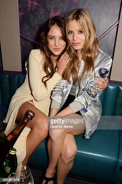 Eliza Cummings and Georgia May Jagger attend the Marchesa S/S 2015 after party sponsored by Revlon at Le Peep Boutique on September 13 2014 in London...
