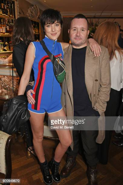 Eliza Cummings and Kim Jones attend the LOVE x Miu Miu Women's Tales dinner hosted by Katie Grand and Elle Fanning at Loulou's on February 19 2018 in...