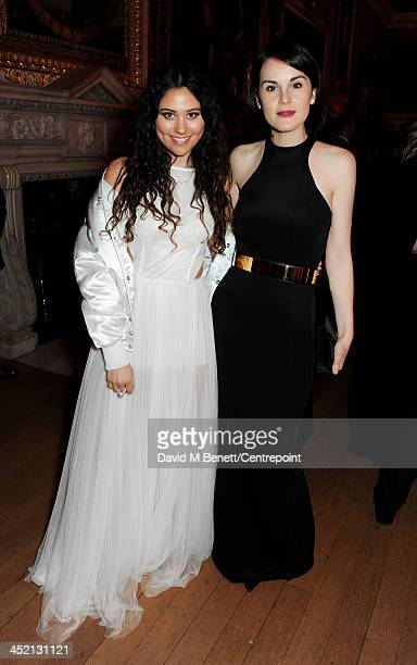 Eliza Doolittle and Michelle Dockery attend the Winter Whites Gala in aid of Centrepoint at Kensington Palace on November 26 2013 in London England