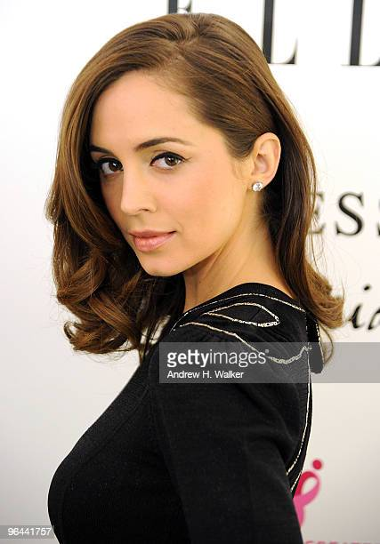 Eliza Dushku walks the red carpet during the Guess by Marciano and ELLE event benefiting the Susan G Komen Foundation at the Guess Boutique on...