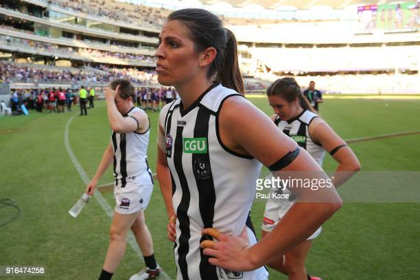Eliza Hynes of the Magpies walks from the ground after being defeated during the round two AFLW match between the Fremantle Dockers and the...
