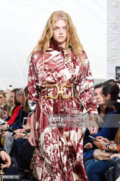 Eliza Kallmann walks the runway during the Celine show as part of the Paris Fashion Week Womenswear Spring/Summer 2018 on October 1 2017 in Paris...