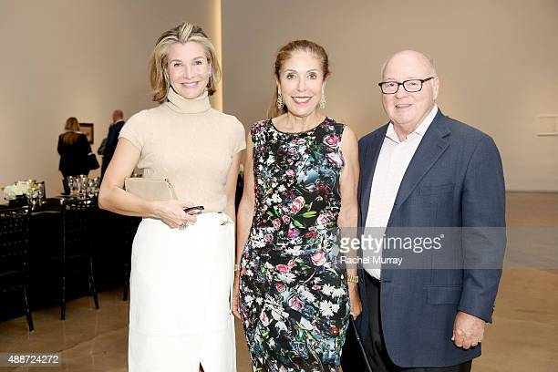 Eliza Osborne Terri Smooke and Michael Smooke attend a dinner reception for the Ryman/Morandi exhibition on September 16 2015 at the Michael Kohn...