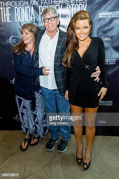 Eliza Roberts and Actors Eric Roberts and Rebecca Grant attend the Screening Of Through My Father's Eyes The Ronda Rousey Story at the TCL Chinese...