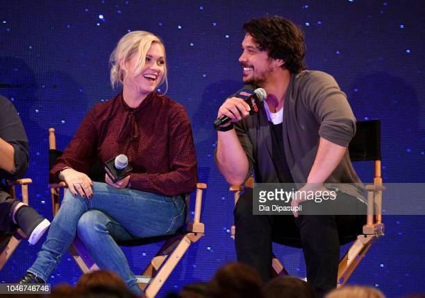 Eliza Taylor and Bob Morley speak onstage at the WBTV Panel Block The 100 panel during New York Comic Con at Jacob Javits Center on October 6 2018 in...