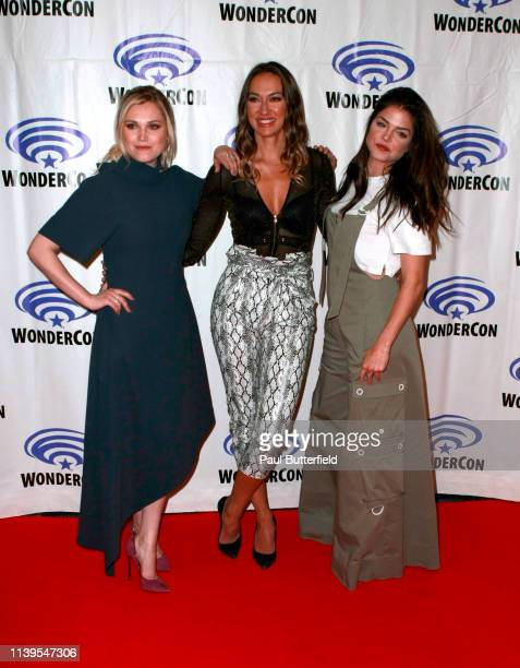 Eliza Taylor Tasya Teles and Marie Avgeropoulos attend the 'The 100' press line during WonderCon 2019 at Anaheim Convention Center on March 31 2019...