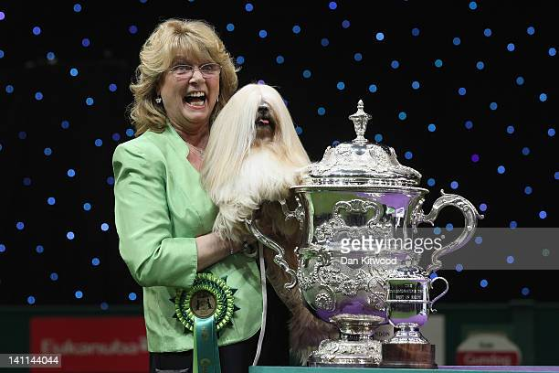 Elizabeth, a Lhasa Apso and owner Margaret Anderson pose for photographs after winning 'Best in Show' at the 2012 Crufts dog show at the National...