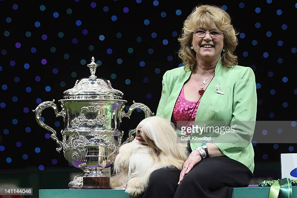 Elizabeth a Lhasa Apso and owner Margaret Anderson pose for photographs after winning 'Best in Show' at the 2012 Crufts dog show at the National...