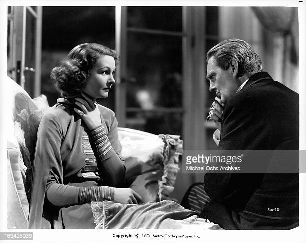 Elizabeth Allan and Lionel Barrymore sitting together in a scene from the film 'Mark Of The Vampire' 1935