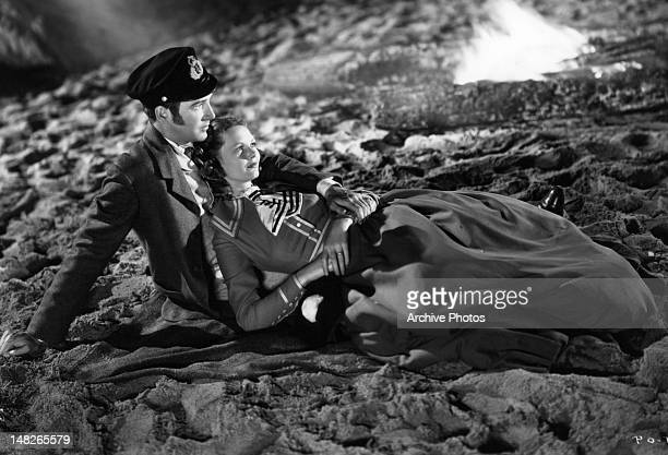 Elizabeth Allan with man on the sand in a scene from the film 'A Woman Rebels' 1936
