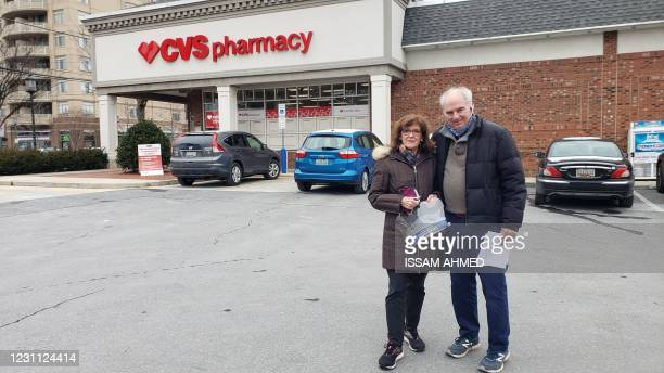 Elizabeth and Ted Pochter pose outside a CVS pharmacy in Bethesda, Maryland, on February 12 after being one of the first to receive a Covid-19...