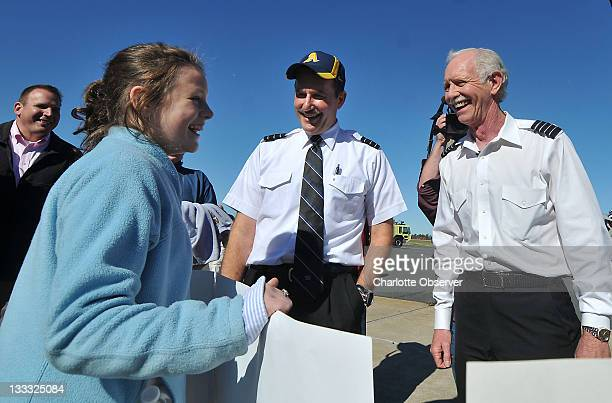 Elizabeth Anthony left greets Jeff Skiles and Capt Chesley Sully Sullenberger outside the Carolinas Aviation Museum on Friday November 18 in...