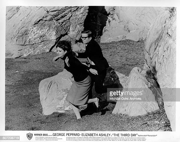 Elizabeth Ashley flees as a attacker Arte Johnson tries to kill her in a scene from the Warner Bros movie The Third Day circa 1965