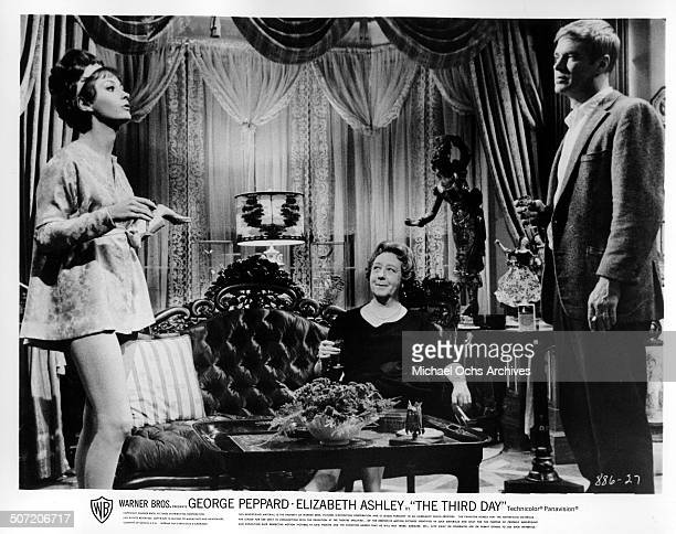 Elizabeth Ashley talks to her husband George Peppard as Mona Washbourne watches in a scene from the Warner Bros movie The Third Day circa 1965