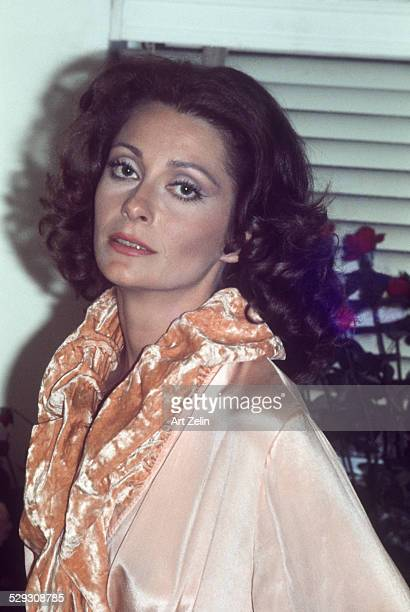 Elizabeth Ashley wearing a peach satin evening coat with crushed velvet collar circa 1970 New York