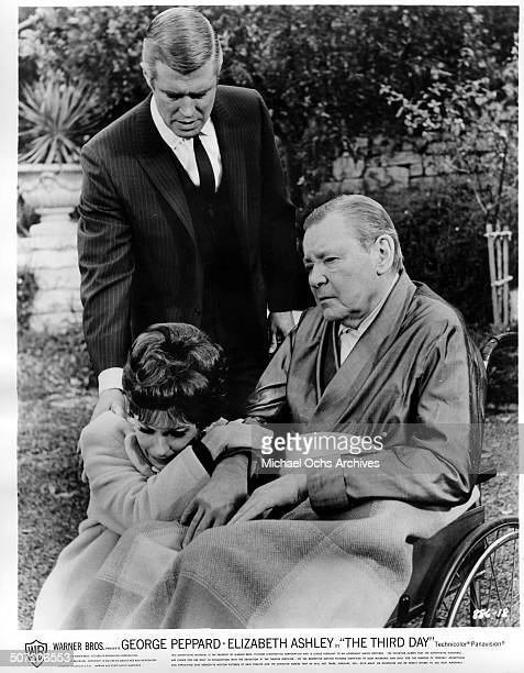 Elizabeth Ashley weeps as she realizes Herbert Marshall is helpless as George Peppard consoles her in a scene from the Warner Bros movie The Third...