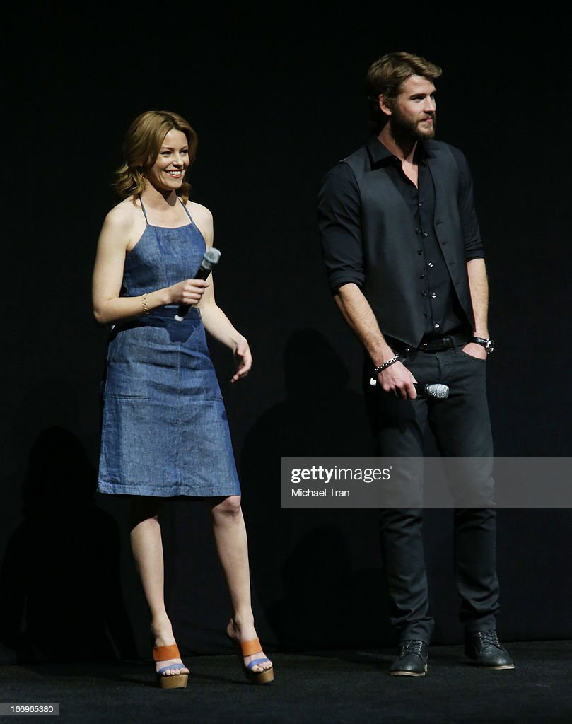 Elizabeth Banks (L) and Chris Hemsworth speak at a Lionsgate presentation to promote their upcoming film, 'The Hunger Games: Catching Fire' held at Caesars Palace during CinemaCon, the official convention of the National Association of Theatre Owners, on April 18, 2013 in Las Vegas, Nevada.