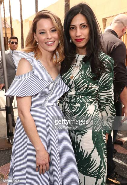 Elizabeth Banks and Huma Abedin attend a Star Ceremony on The Hollywood Walk Of Fame Honoring Haim Saban on March 22 2017 in Hollywood California