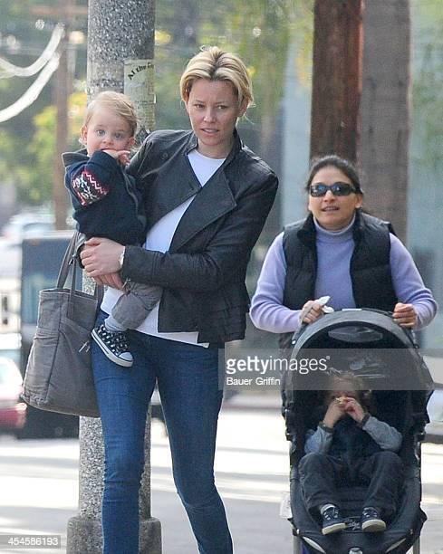 Elizabeth Banks is seen taking a walk with her sons, Magnus Handelman and Felix Handelman on December 09, 2013 in Los Angeles, California.