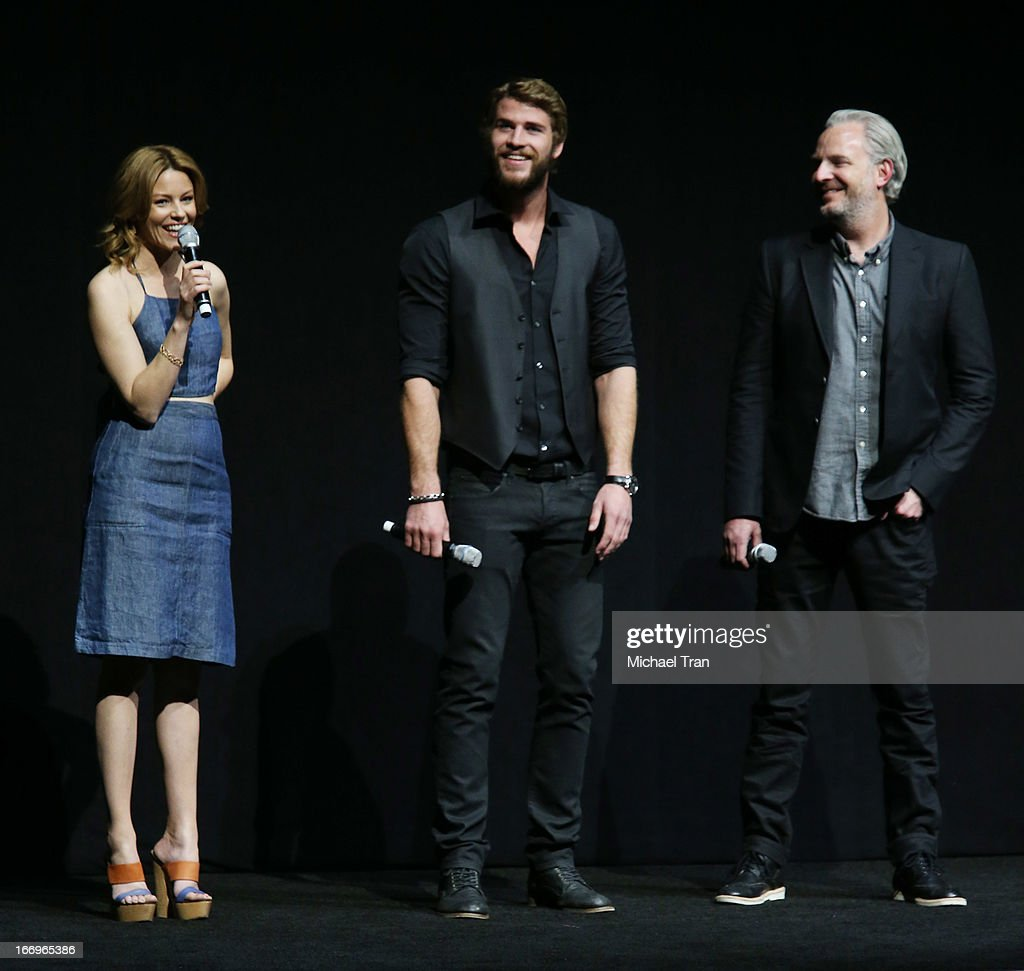Elizabeth Banks, Liam Hemsworth and Francis Lawrence speak at a Lionsgate presentation to promote their upcoming film, 'The Hunger Games: Catching Fire' held at Caesars Palace during CinemaCon, the official convention of the National Association of Theatre Owners, on April 18, 2013 in Las Vegas, Nevada.