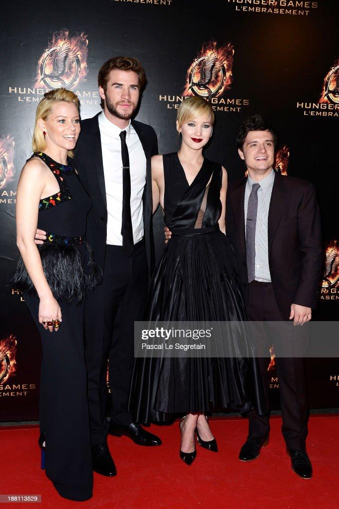 Elizabeth Banks, Liam Hemsworth, Jennifer Lawrence and Josh Hutcherson attend 'The Hunger Games: Catching Fire' Paris Premiere at Le Grand Rex on November 15, 2013 in Paris, France.