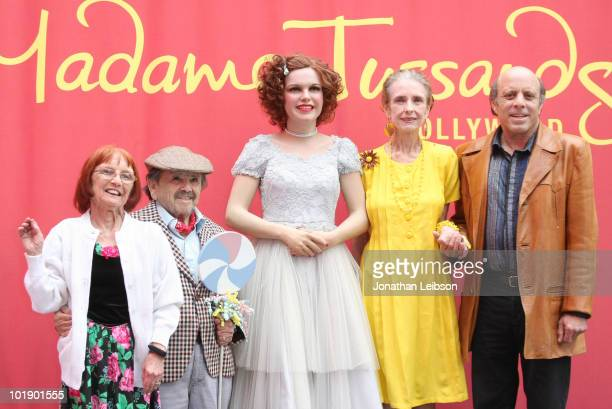 Elizabeth Barrington, Jerry Maren, Margaret O'Brien, and Joey Luft pose with a wax figure of movie icon Judy Garland at Madame Tussauds on June 8,...