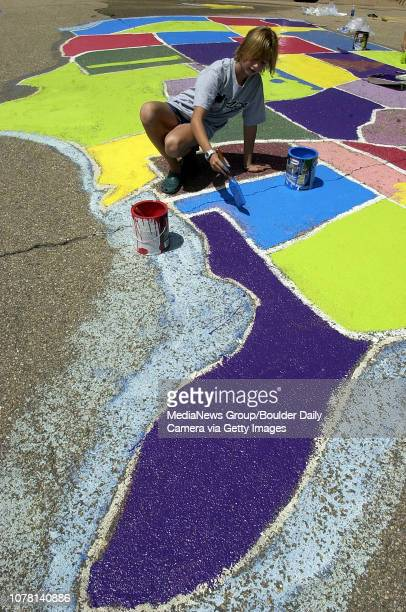 Elizabeth Belton helps paint the United States map on the playground at Birch Elementary School on Friday The project was a possible with a...