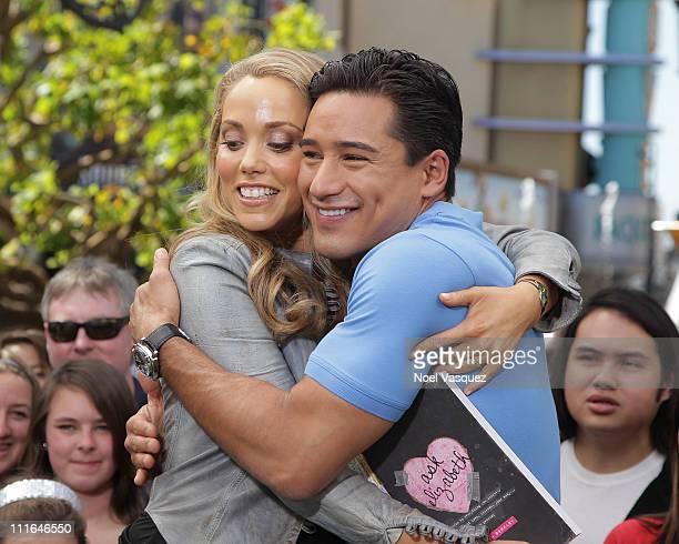Elizabeth Berkley and Mario Lopez visit Extra at The Grove on April 4 2011 in Los Angeles California