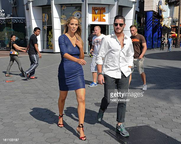 Elizabeth Berkley and Val Chmerkovskiy are sighted at Universal Studios Hollywood on September 18 2013 in Los Angeles California