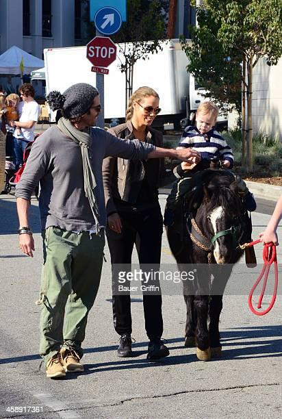 Elizabeth Berkley, Greg Lauren and their son, Sky Cole Lauren, are seen at the Studio City Farmers Market on December 22, 2013 in Los Angeles,...