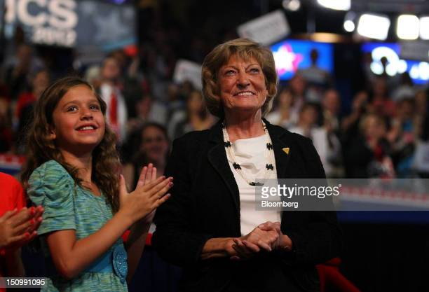 """Elizabeth """"Betty"""" Ryan, mother of Republican vice presidential candidate Paul Ryan, right, and Liza Ryan, daughter of Paul Ryan, smile while Ryan..."""