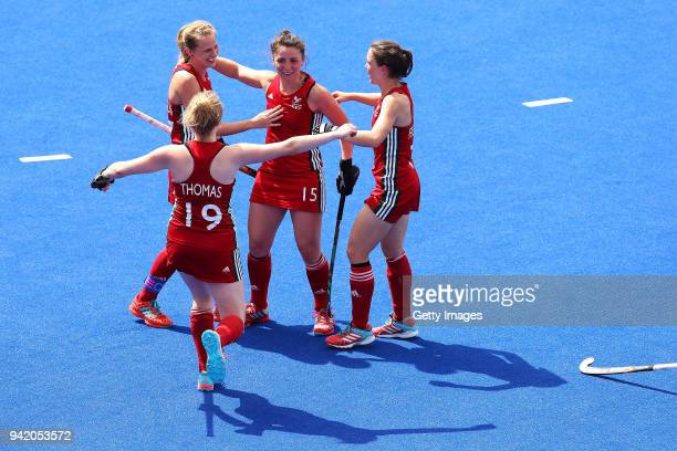 Elizabeth Bingham of Wales celebrates victory with team mates during the Pool A Hockey match between Wales and India on day one of the Gold Coast...