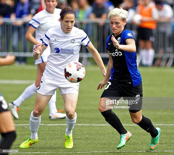 Elizabeth Bogus of FC Kansas City and Jessica Fishlock of Seattle Reign FC fight for the ball in the second half of the National Women's Soccer...