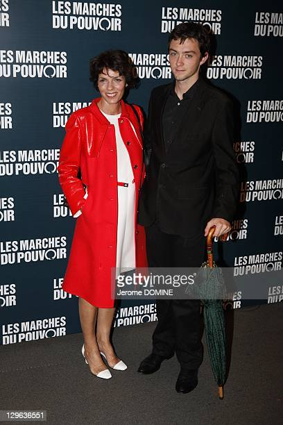 Elizabeth Bourgine and her son Jules attend 'The Ides of March' Paris Premiere at Cinema UGC Normandie on October 18 2011 in Paris France
