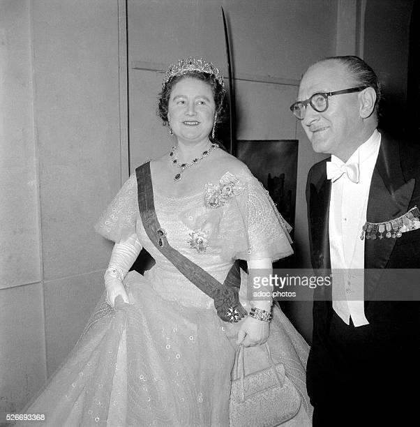 Elizabeth BowesLyon and Guy Mollet in Paris In 1956